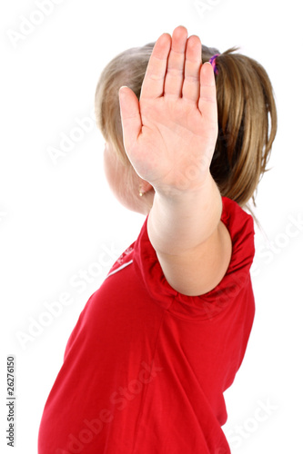 Small girl shows denial with her hand isolated on white