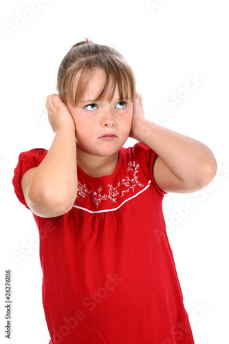 Girl holding her ears with her hands so that she can't listen