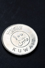 Kuwait 100 dinar coin in black background