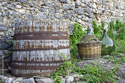 Rural scene,old wood barrel and glass demijohn for wine