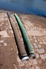 flexible tube for liquid manure disposal in the river