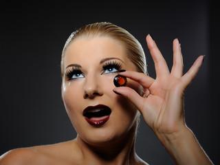 pretty woman with bright make-up and orange jewel stone