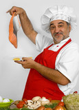 cheerful cook in red apron preparing salmon poster