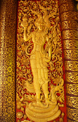 DOOR WOODCARVING IN THAI TEMPLE