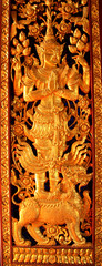 Buddha carved gold pain on temple door