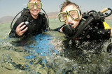 mother and son scuba dive poster