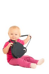 cute adorable baby play with small backpack on white