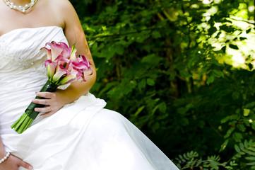 Bride showing off her wedding bouquet