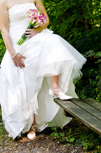 Bride showing off wedding dress and shoes