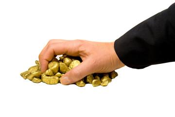 Hand greift nach Gold