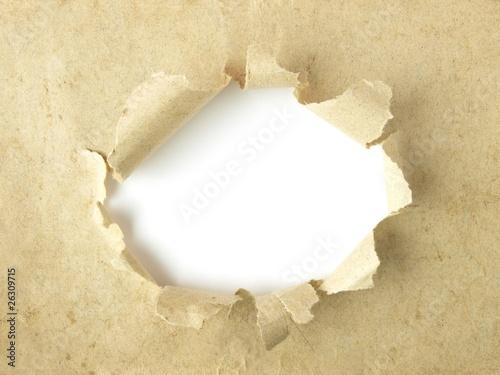Agujero blanco sobre papel antiguo