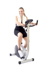 Woman exercising with bicycle indoor