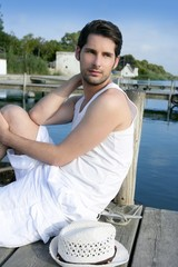 Mediterranean young man relaxed on wood pier