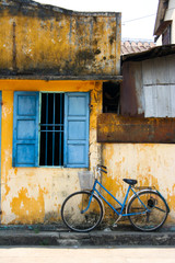 a bicycle and blue window