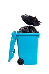 garbage in a blue wheelie bin isolated over white