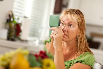 Blonde Woman Applying Her Makeup