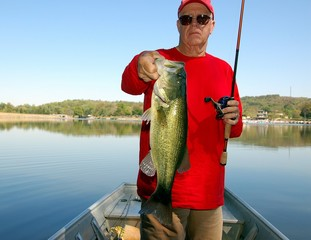 fisherman with bass