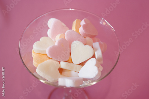 hearts in glass on pink background
