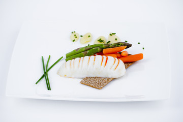 Diet meal, asparagus with carrots and sea food