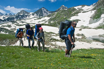 Group of hikers in mountain wally.