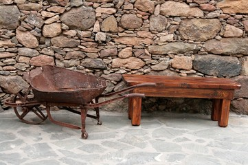 Bench and old wheelbarrow