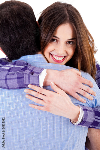 closeup of lady hugging man