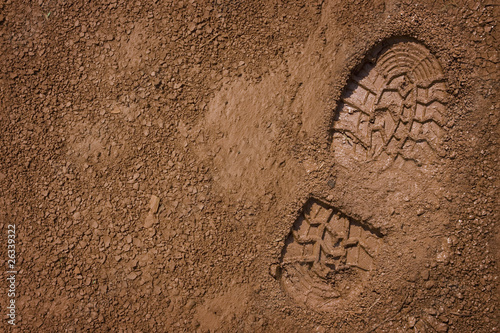 Footprint on mud with copy space
