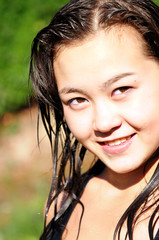 Young Asian girl with wet hair  smiling