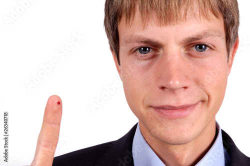 man showing his finger with drop of blood isolated