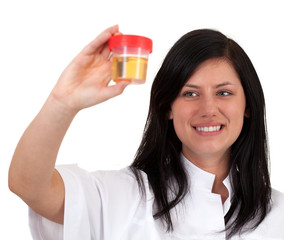 young female doctor keeping urine to analysis