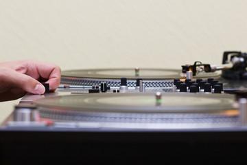 Hand of a dj adjusting the crossfader