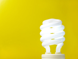 a yellow energy efficient light bulb.
