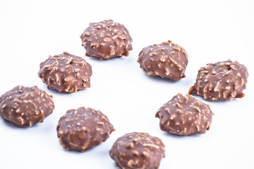 Chocolate candy over white background.