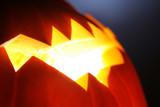 Glowing Jack-O-Lantern detail, close-up background