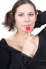 Portrait of pretty woman in black eating candy