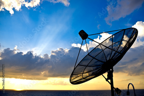 satellite dish silhoette on sunset background - 26357920