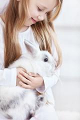 Girl and rabbits