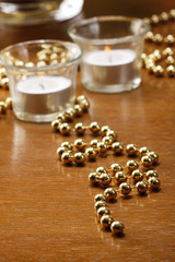 Glasses of champagne with gold background with walnuts, candels