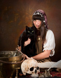 Young witch with black cat