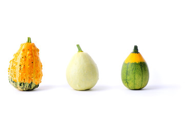three coloured gourds on white background