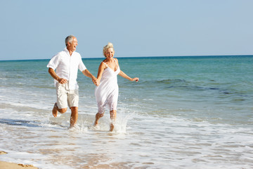 Senior Couple Enjoying Beach Holiday
