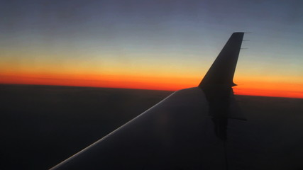 Aerial view of sunset over airplane wing
