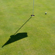 Golf hole, flag and ball