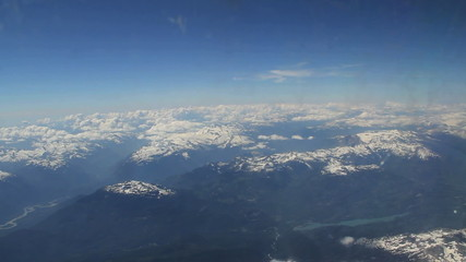 Aerial view of snow capped mountains from airplane