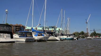 Boat travels through marina 1920x1080 HD