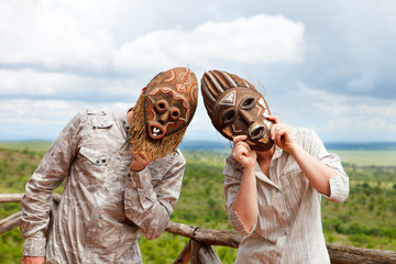 Couple in African masks