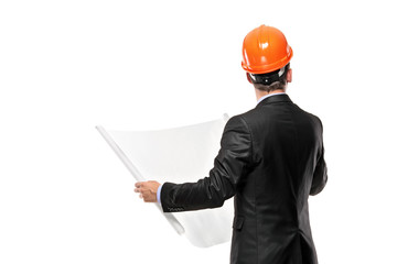 Male architect looking at blueprints