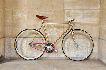 A fixed-gear bicycle with a pink chain