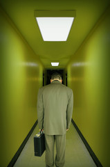 Tired Stressed Business Man Walking Hallway