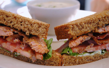 Grilled salmon sandwich on pumpernickel bread